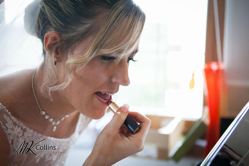 Ocean Kave wedding, bride putting on lipstick