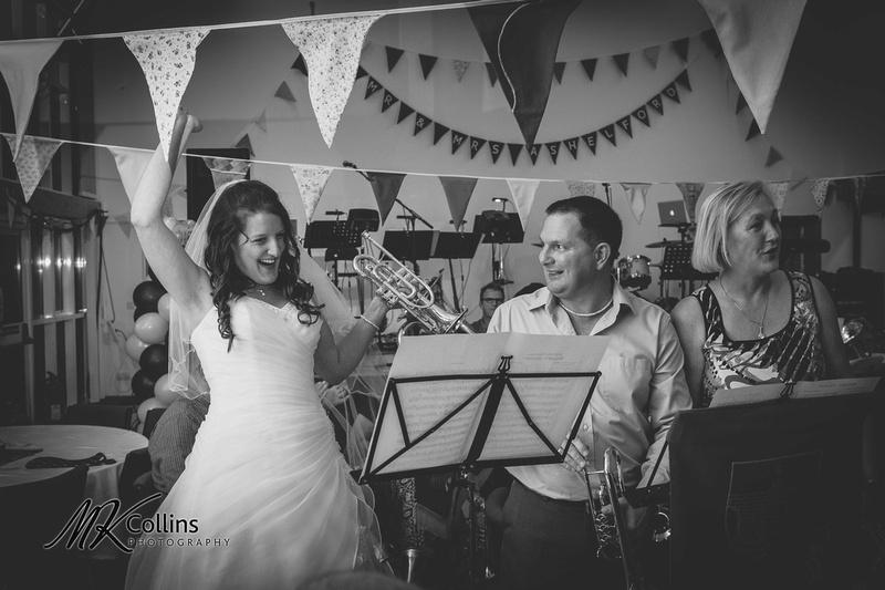 Bride playing trumpet at wedding!
