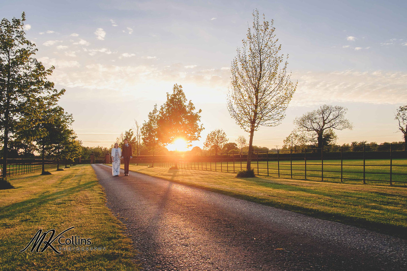 sunset at Muddifords Court with bride and groom